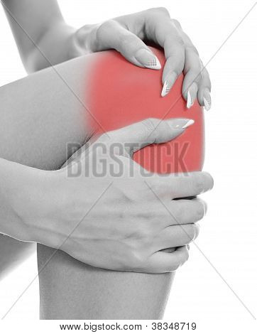 Close Up View Of Male Hands Holding His Sore Knee. Isolated On White.black And White