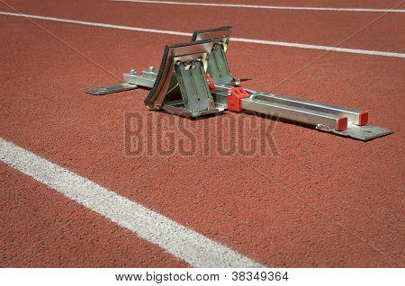 Starting Blocks On Red Tartan Running Track