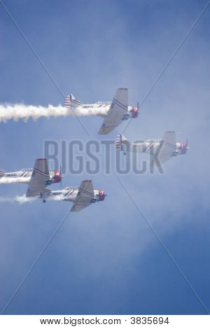 Four Geico Skytypers Flying