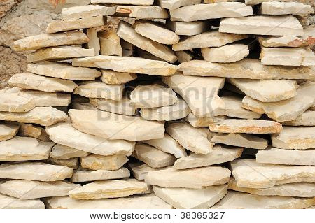 Heap of flat paving stones limestone, construction material