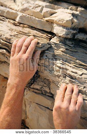 Rock climber detail of hands, Vrboska, Hvar, Croatia