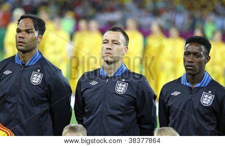 Joleon Lescott, John Terry y Danny Welbeck de Inglaterra