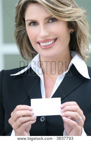 Headshot Of A Business, Corproate Woman, With Business Card
