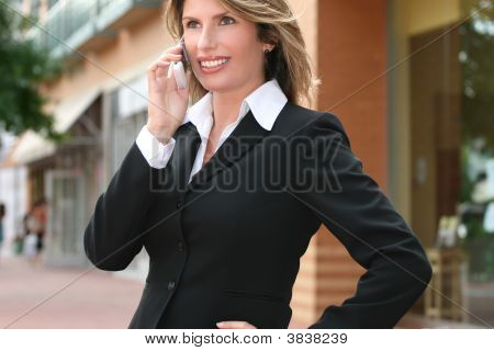 Business Woman Outdoors On Cell Phone