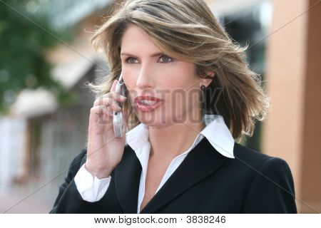 Business Woman Worried On Cell Phone, Thinking About A Problem