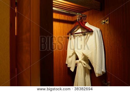 Close Up Of Clothes Hanger And Twins Bathrobe
