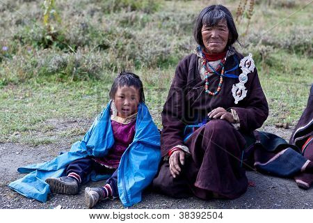 Tibetan woman and boy