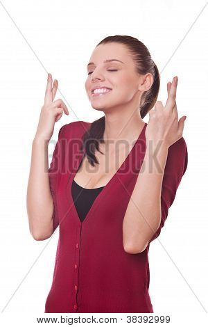 Woman Shows Crossed Fingers