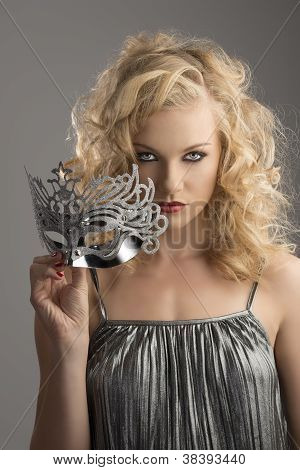 Blonde Girl With Silver Mask In Front Of The Camera