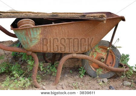 Rusty_Wheelbarrow_On_White_Background