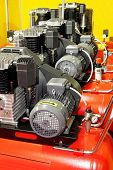 stock photo of air compressor  - Several red powerful air compressors in line - JPG