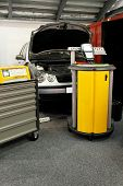 image of car repair shop  - Car service garage with diagnose test equipment - JPG