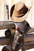 stock photo of projectile  - gun and hat under sunlight - JPG