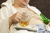 pic of beer-belly  - Drunk man asleep with a beer in the hands of - JPG