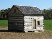 stock photo of log cabin  - Log Cabin at the Tippecanoe Wildlife Park in Marshall County Indiana - JPG
