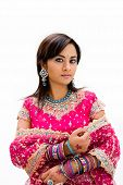 stock photo of indian wedding  - Beautiful Bangali bride in colorful dress isolated - JPG