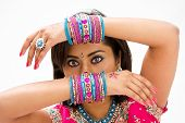 foto of bangla  - Beautiful face of a Bengali bride witharms across her head covered with colorful bracelets isolated - JPG
