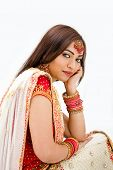 stock photo of indian wedding  - Beautiful Bengali bride in colorful dress day dreaming isolated - JPG