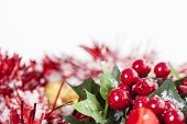 picture of winterberry  - Christmas border with red Holly berries and ribbon covered by snow with copy space - JPG