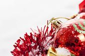 foto of winterberry  - Christmas border with red bauble winterberries and decoration covered by snow - JPG