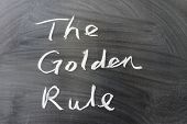 stock photo of maxim  - The golden rule words written on the chalkboard - JPG