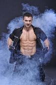 picture of bodybuilder  - Good Looking Policeman Bodybuilder Posing in smoke - JPG