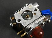 image of carburetor  - Stock pictures of a small gas engine and a carburetor