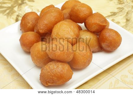 Awama or awamat, Middle Eastern syrup-soaked fried sponge ball which is a common Ramadan treat and a  Lebanese dessert