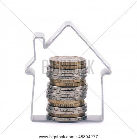 House and stack of euro coins. Clipping path included.