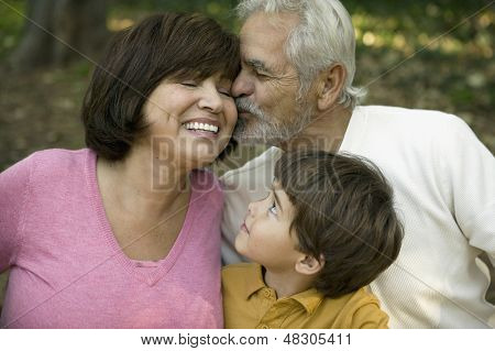 Little boy smiling at grandparents