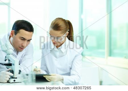 Two clinicians working in laboratory