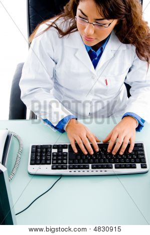 High Angle View Of Doctor Working On Computer