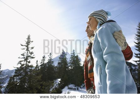 Low angle view of a couple looking at view against sky