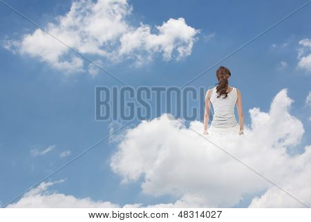 Brunet woman sit on clouds and look far away, concept of lifestyle, relaxation, free and holiday etc.
