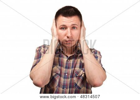 Man in plaid shirt with closed ears