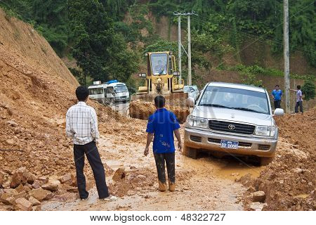Bulldozer clears the road because of landslide