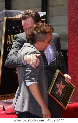 LOS ANGELES - JUL 16:  Frankie Muniz, Bryan Cranston at the Hollywood Walk of Fame Star Ceremony for Bryan Cranston at the Redbury Hotel on July 16, 2013 in Los Angeles, CA