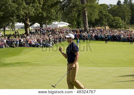 LOCH LOMOND, SCOTLAND - JUL 12 2009; Loch Lomond Scotland; Martin Kaymer (GER) pumps his fist after sinking the winning putt in the final round of the PGA European Tour Barclays Scottish Open golf tournament.