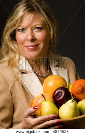Pretty Older Woman In Suit Fruit Bowl
