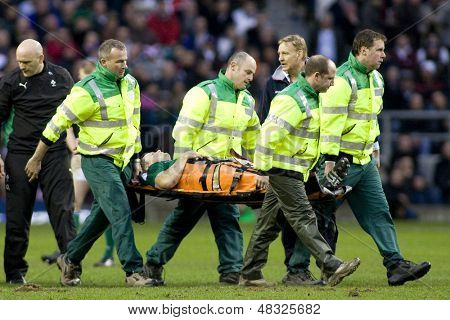 TWICKENHAM LONDON, 27/02/2010. Ireland team captain Brian O'Driscoll is carried off on the stretcher during the RBS 6 Nations rugby union match between England and Ireland at the Twickenham Stadium.
