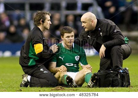 TWICKENHAM LONDON, 27/02/2010. Ireland captain Brian O'Driscoll gets treated by the Irish medical team during the RBS 6 Nations rugby union match between England and Ireland at the Twickenham Stadium.