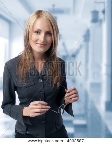 Girl Holding Spectacles