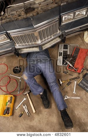 Mechanic Under The Car