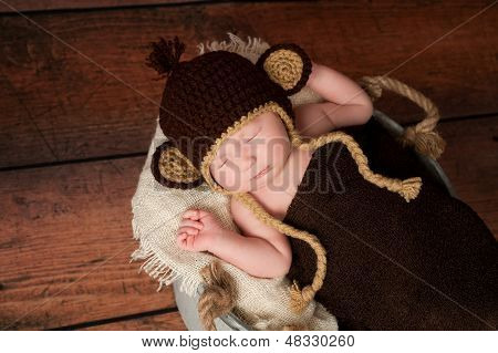 Newborn Baby Wearing A Monkey Hat
