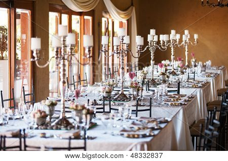 Hall At A Wedding With Decorated Tables