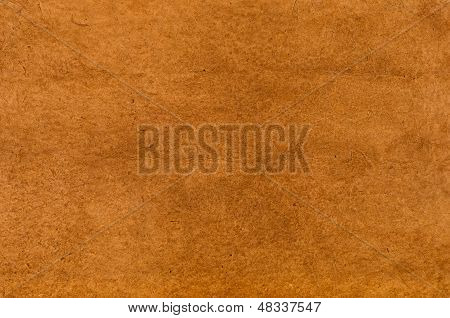 a sheet of brown daphnepaper with leathery texture