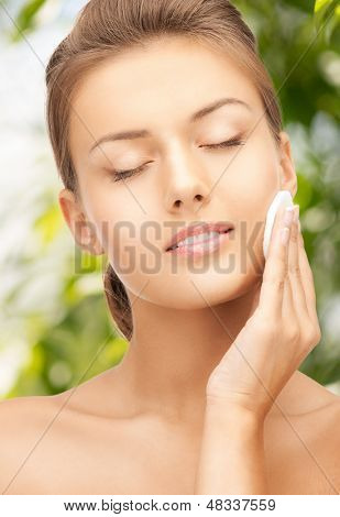 beauty and eco cosmetology concept - beautiful woman with cotton pad
