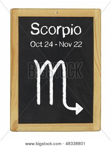 the zodiac sign Scorpio on a blackboard
