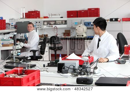 Technicians Working In A Modern Laboratory