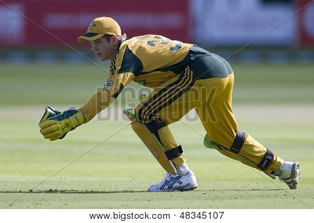 LONDON - 12 SEPT 2009; London England: Australia team wicket keeper Timothy Paine reaches out in an attempt to stop a ball during the Nat West, 4th one day international cricket match at Lords Cricket ground